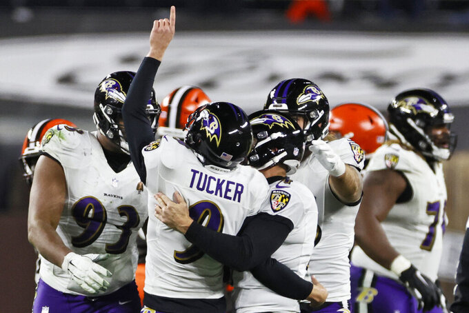 Baltimore Ravens kicker Justin Tucker (9) celebrates with teammates after kicking a 55-yard field goal during the second half of an NFL football game against the Cleveland Browns, Monday, Dec. 14, 2020, in Cleveland. The Ravens won 47-42. (AP Photo/Ron Schwane)