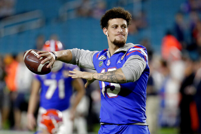 FILE - In this Dec. 30, 2019, file photo, Florida quarterback Feleipe Franks warms up before the Orange Bowl NCAA college football game against Virginia in Miami Gardens, Fla. New Arkansas coach Sam Pittman will have Franks, a graduate transfer from Florida, to run his offense. (AP Photo/Lynne Sladky, File)