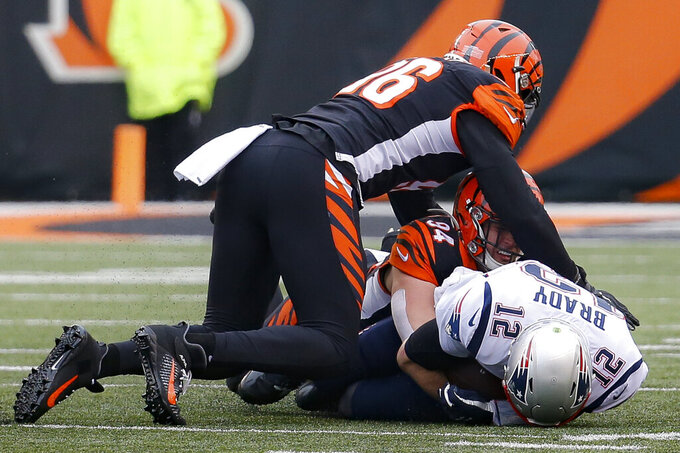 New England Patriots quarterback Tom Brady (12) is sacked by Cincinnati Bengals defensive end Sam Hubbard (94) in the first half of an NFL football game, Sunday, Dec. 15, 2019, in Cincinnati. (AP Photo/Frank Victores)
