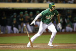 Oakland Athletics' Matt Olson drops his bat after hitting a groundout during the second inning of the team's baseball game against the Detroit Tigers on Friday, Sept. 6, 2019, in Oakland, Calif. A run scored on the play. (AP Photo/Ben Margot)