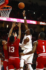 Maryland forward Bruno Fernando, second from right, of Angola, shoots over Indiana forward Justin Smith, from left, forward Juwan Morgan and guard Aljami Durham in the second half of an NCAA college basketball game, Friday, Jan. 11, 2019, in College Park, Md.  (AP Photo/Patrick Semansky)