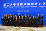 German Finance Minister Olaf Scholz and Chinese Vice Premier Liu He and both countries' delegates pose for a group photo before the China-Germany High Level Financial Dialogue at the Diaoyutai State Guesthouse in Beijing, Friday, Jan. 18, 2019. (AP Photo/Andy Wong, Pool)
