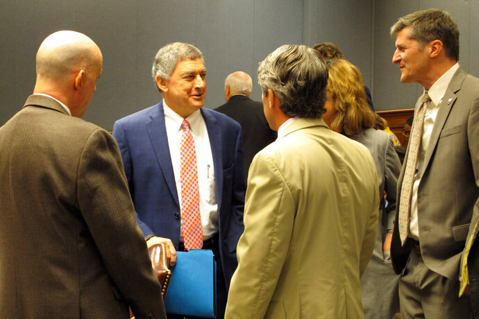 Commissioner of Administration Jay Dardenne, second from left, the governor's chief budget adviser, speaks to budget analysts and lawmakers at the House and Senate budget committee meeting on Friday, Sept. 13, 2019, in Baton Rouge, La. Dardenne told lawmakers that Louisiana's surplus estimate has grown to $500 million. (AP Photo/Melinda Deslatte)