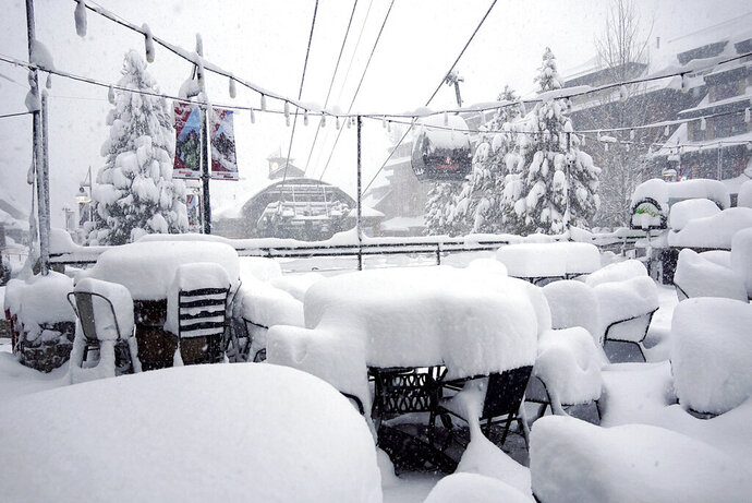 This Friday, Feb. 15, 2019, photo released by Heavenly Mountain Resort shows snow covering chairs and ski equipment at Heavenly Mountain Resort near South Lake Tahoe, Calif. Skiers eager to hit the slopes had to sit out a Presidents' Day holiday weekend as heavy snow and rain fell for a fourth straight day Friday in California's mountains, where the snow was so deep in some areas plows couldn't go out and cities were running out of places to pile it. (Duncan Kincheloe/Heavenly Mountain Resort via AP)