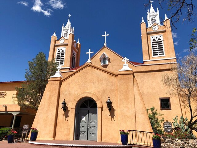 The doors at San Felipe de Neri Catholic Church in the Old Town historic district of Albuquerque, New Mexico, remain closed Thursday, April 9, 2020. The Archdiocese of Santa Fe is urging parishioners to stay home during Holy Week as state public health orders prompted by the coronavirus outbreak limit gatherings and social contact. (AP Photo/Susan Montoya Bryan)