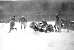 FILE - In this Dec. 1948, file photo, Steve Van Buren (15) of the Philadelphia Eagles plunges over the goal line with a fourth period touchdown that defeated the Chicago Cardinals in a snowstorm in Philadelphia. Other players are, Bill Blackburn (57) and John Cochrane (24) of the Cardinals. Van Buren was a four-time NFL rushing champion for the Eagles while leading the league in punt returns as a rookie in 1944 and kickoff returns in 1945. The former LSU star was the first player with multiple 1,000-yard rushing seasons while finishing with 5,860 yards before retiring at 30 after eight seasons. (AP Photo/File)