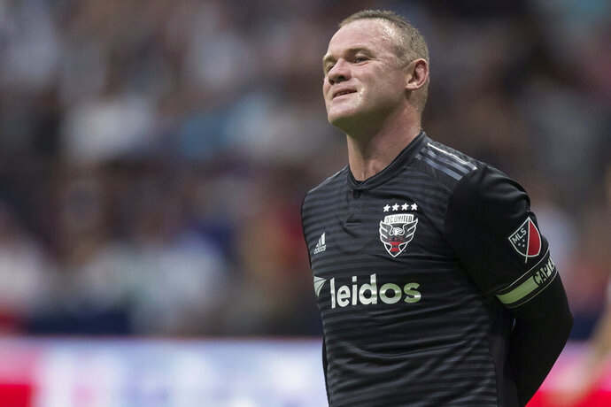 FILE - In this Aug. 17, 2019, file photo, D.C. United's Wayne Rooney reacts after putting a shot over top of the Vancouver Whitecaps' goal during the first half of an MLS soccer match in Vancouver, British Columbia. As his Major League Soccer career draws to a close and he prepares to return home, Wayne Rooney would like one more shot at the playoffs stateside. (Darryl Dyck/The Canadian Press via AP, File)