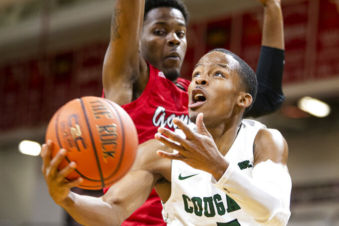 Chicago State guard Xavier Johnson (5) drives to the basket in the first half of an NCAA college basketball game against Jacksonville State at the Emerald Coast Classic in Niceville, Fla., Friday, Nov. 29, 2019. (AP Photo/Mark Wallheiser)