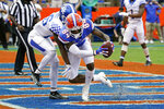 Florida tight end Kyle Pitts (84) catches a pass in front of Kentucky defensive back Brandin Echols for a 2-yard touchdown on a pass play during the second half of an NCAA college football game, Saturday, Nov. 28, 2020, in Gainesville, Fla. (AP Photo/John Raoux)