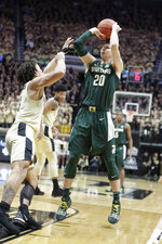 Michigan State guard Matt McQuaid (20) shoots over Purdue guard Carsen Edwards (3) during the first half of an NCAA college basketball game in West Lafayette, Ind., Sunday, Jan. 27, 2019. (AP Photo/Michael Conroy)