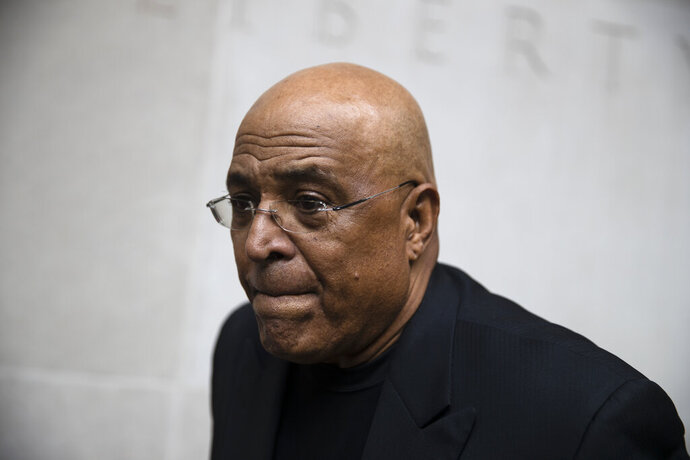 FILE - In this Aug. 1, 2017, file photo, former Reading Mayor Vaughn Spencer departs from the federal courthouse in Philadelphia. The former Pennsylvania mayor who rewarded individuals and businesses that donated to his campaign with expensive city contracts will be sentenced. (AP Photo/Matt Rourke, File)