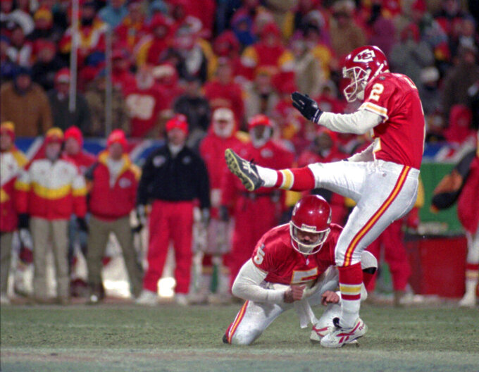 FILE - In this Jan. 7, 1996, file photo, Kansas City Chiefs kicker Lin Elliott attempts a 42-yard field goal that missed wide of the goal and would have tied the game in the final minutes of the AFC divisional playoff game against the Indianapolis Colts, in Kansas City. The miss gave the Colts a 10-7 victory. Holding on the play it the Chiefs' Louie Aguiar. Given the postseason history involving Indianapolis and Kansas City over the years, Andrew Luck and the Colts have every reason to feel confident heading to Arrowhead Stadium on Saturday.(AP Photo/Ed Zurga, File)