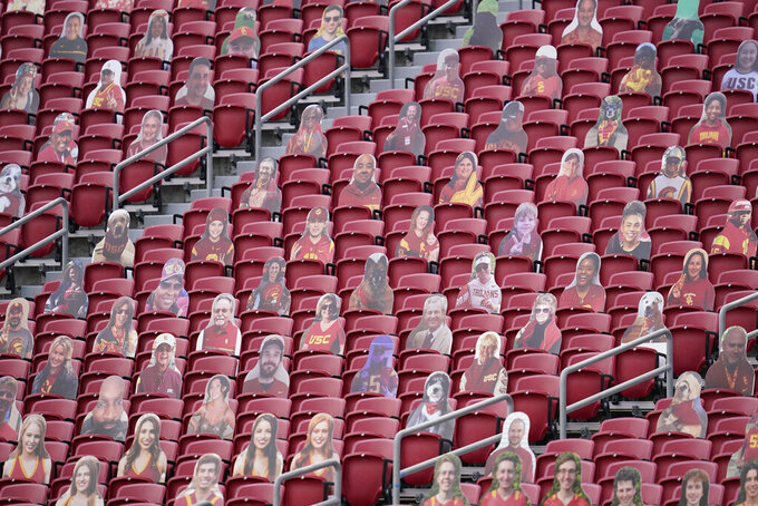 Cardboard cutouts of Southern California fans are displayed in empty stands during the first half of an NCAA college football game against Arizona State, Saturday, Nov. 7, 2020, in Los Angeles. (AP Photo/Ashley Landis)