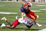 Nebraska cornerback Quinton Newsome tackles Illinois running back Mike Epstein during the first half of an NCAA college football game Saturday, Aug. 28, 2021, in Champaign , Ill. (AP Photo/Charles Rex Arbogast)