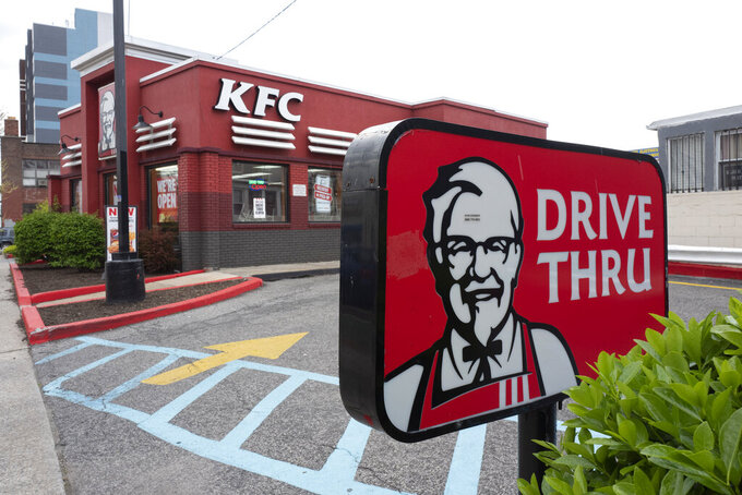 A KFC restaurant is open, Wednesday, April 21, 2021, in New York.  Yum Brands' first-quarter profit more than tripled from a year ago, while sales were bolstered by strong performances from its Pizza Hut and KFC brands in the U.S. The parent company of KFC, Taco Bell and Pizza Hut earned $326 million, or $1.07 per share, for the period ended March 31.  (AP Photo/Mark Lennihan)