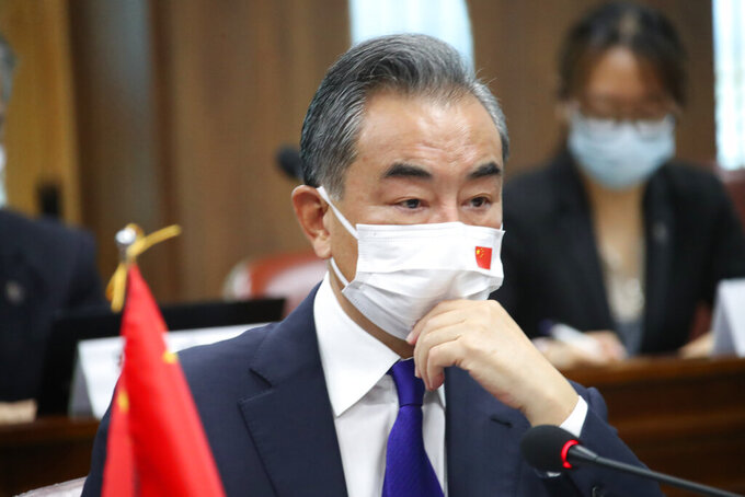 Chinese Foreign Minister Wang Yi attends a meeting with his South Korean counterpart Chung Eui-yong at Foreign Ministry in Seoul, South Korea, Wednesday, Sept. 15, 2021. The foreign ministers met Wednesday for talks expected to focus on North Korea and other regional security issues, two days after North Korea claimed to have tested a newly developed cruise missile. (Kim Seung-doo/Yonhap via AP)