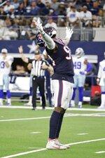 Houston Texans defensive end Charles Omenihu (94) celebrates sacking Dallas Cowboys quarterback Cooper Rush in the first half of a preseason NFL football game in Arlington, Texas, Saturday, Aug. 21, 2021. (AP Photo/Michael Ainsworth)