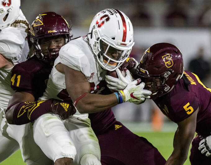 Stanford's Bryce Love gets stuffed at the line by Arizona State's Tyler Johnson (41) and Kobe Williams (5) during the first half of an NCAA college football game Thursday, Oct. 18, 2018, in Tempe, Ariz. (AP Photo/Darryl Webb)