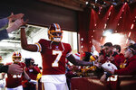Washington Redskins quarterback Dwayne Haskins (7) greets fans before the start of an NFL football game against the Philadelphia Eagles, Sunday, Dec. 15, 2019, in Landover, Md. (AP Photo/Patrick Semansky)