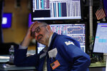 Specialist Peter Giacchi works on the floor of the New York Stock Exchange, Friday, Aug. 23, 2019. Stocks tumbled on Wall Street after President Donald Trump said he
