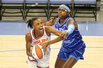Chicago Sky's Diamond DeShields, right, pressures Connecticut Sun's DeWanna Bonner during the first quarter of a WNBA basketball game Thursday, June 17, 2021, in Chicago. (AP Photo/Charles Rex Arbogast)