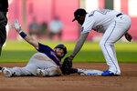 Minnesota Twins' Josh Donaldson beats the tag by Kansas City Royals second baseman Hanser Alberto after hitting a double during the first inning of a baseball game Friday, July 2, 2021, in Kansas City, Mo. (AP Photo/Charlie Riedel)