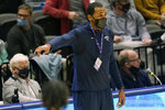 Shawnee State head coach Delano Thomas directs his team during the first half of an NAIA basketball game against Lewis-Clark State in the finals of the national tournament in Kansas City, Mo., Tuesday, March 23, 2021. (AP Photo/Orlin Wagner)
