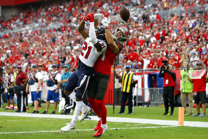 Houston Texans cornerback Bradley Roby (21) breaks up a pass intedned for Tampa Bay Buccaneers tight end Cameron Brate (84) during the first half of an NFL football game Saturday, Dec. 21, 2019, in Tampa, Fla. (AP Photo/Mark LoMoglio)