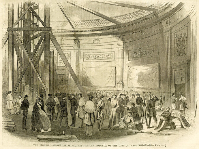 This illustration in the May 25, 1861 issue of Harper's Weekly depicts the Eighth Massachusetts Regiment with some civilians, and mattresses on the floor in the rotunda of the Capitol in Washington. To most Americans, the sight of armed National Guard troops sleeping in the Capitol Rotunda this past week was shocking and disturbing. But it also was an echo of the far-distant past — the Capitol was used as a bivouac for troops during the Civil War. (Harper's Weekly/Wilson's Creek National Battlefield via AP)