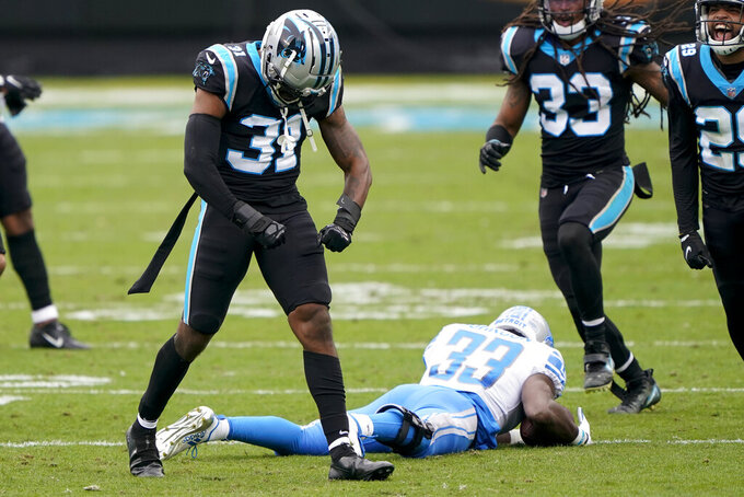 Carolina Panthers strong safety Juston Burris celebrates after tackling Detroit Lions running back Kerryon Johnson during the first half of an NFL football game Sunday, Nov. 22, 2020, in Charlotte, N.C. (AP Photo/Brian Blanco)