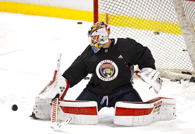 Florida Panthers goalie Chris Driedger (60) blocks a shot during training camp in preparation for the 2021 NHL season at the BB&T Center on Sunday, January 10, 2021 in Sunrise.(David Santiago/Miami Herald via AP)