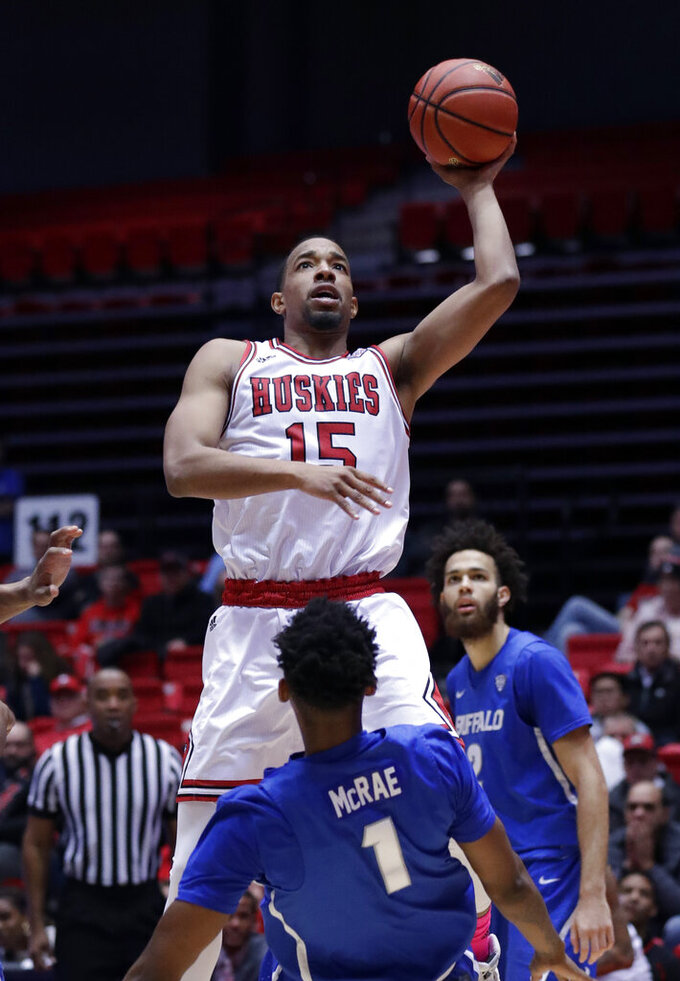 Northern Illinois forward Jaylen Key (15) goes up for a shot against Buffalo forward Montell McRae (1)during the second half of an NCAA college basketball game Tuesday, Jan. 22, 2019, in DeKalb, Ill. Northern Illinois won 77-75. (AP Photo/Nam Y. Huh)