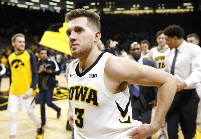 Iowa's Jordan Bohannon walks off the court after Iowa won 72-62 and Bohannon scored his 1,000th career point in an NCAA college basketball game against Ohio State, Saturday, Jan. 12, 2019, in Iowa City, Iowa. (AP Photo/Matthew Putney)