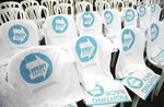 T-shirts and posters are seen on chairs during the launch of the Brexit Party's European election campaign, Coventry, England, Friday, April 12, 2019. On Friday, Nigel Farage launched the campaign of his newly formed Brexit Party. The former U.K. Independence Party leader said delays to Brexit were