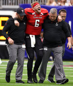 Texas Tech quarterback McLane Carter (6) is helped off the field after sustaining an injury during the first half of a college football game against Mississippi, Saturday, Sept. 1, 2018, in Houston. (AP Photo/Eric Christian Smith)