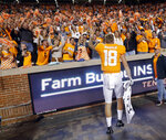 FILE - In this Oct. 26, 2019, file photo, Tennessee quarterback Brian Maurer (18) celebrates with fans after their 41-21 win over South Carolina in an NCAA college football game at Neyland Stadium in Knoxville, Tenn. Tennessee will be selling tickets for approximately 25% of the seats at Neyland Stadium this season, officials announced Tuesday, Aug. 25, 2020. The Volunteers' first home game is Oct. 3 against Missouri and university officials say restrictions could change during the season based on statewide virus data and recommendations from public health officials.(AP Photo/Wade Payne, File)