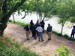 Mexican authorities stand along the Rio Grande bank where the bodies of Salvadoran migrant Oscar Alberto Martínez Ramírez and his nearly 2-year-old daughter Valeria were found, in Matamoros, Mexico, Monday, June 24, 2019, after they drowned trying to cross the river to Brownsville, Texas. Martinez' wife, Tania told Mexican authorities she watched her husband and child disappear in the strong current. (AP Photo/Julia Le Duc)