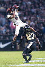 Oregon State wide receiver Trevon Bradford (8) makes a catch over Purdue cornerback Cory Trice (23) during the second half of an NCAA college football game in West Lafayette, Ind., Saturday, Sept. 4, 2021. (AP Photo/Michael Conroy)