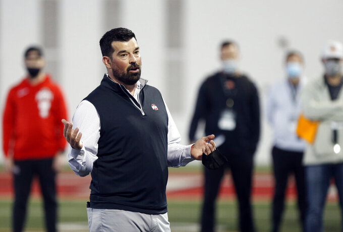 FILE - Ohio State football coach Ryan Day welcomes coach and scouts to an NFL Pro Day at Ohio State University in Columbus, Ohio, in this Tuesday, March 30, 2021, file photo. With two-time Big Ten player of the year Justin Fields departing for the NFL, returning backups C.J. Stroud and Jack Miller III and five-star January enrollee Kyle McCord took the snaps in spring practice. Stroud was believed to be the front-runner entering the spring, but coach Ryan Day said a starter might not be determined until the week of the Sept. 2 opener at Minnesota. (AP Photo/Paul Vernon, File)