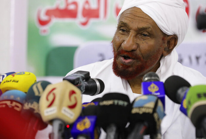 """FILE - In this Feb. 6, 2020 file photo, former Sudanese Prime Minister Sadiq al-Mahdi, left, leader of the Umma political party speaks during a news conference in Khartoum, Sudan.  Al-Mahdi has slammed an announcement by President Donald Trump that Sudan would start normalizing ties with Israel. Al-Mahdi said Saturday, Oct. 24,  the announcement """"contributes to the elimination of the peace project in the Middle East and to preparing for the ignition of a new war."""" (AP Photo/Marwan Ali, File)"""
