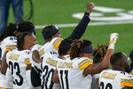 Pittsburgh Steelers players react during the national anthem before playing against the New York Giants in an NFL football game Monday, Sept. 14, 2020, in East Rutherford, N.J. (AP Photo/Seth Wenig)