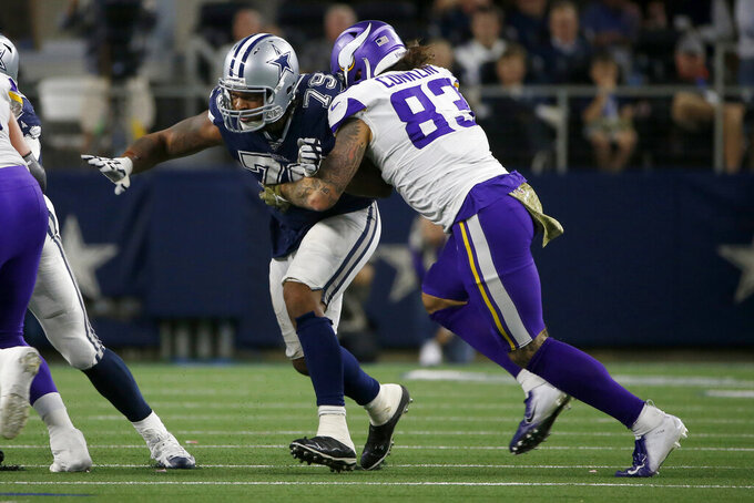 Dallas Cowboys defensive lineman Michael Bennett (79) rushes as Minnesota Vikings tight end Tyler Conklin (83) blocks during the second half of an NFL football game in Arlington, Texas, Sunday, Nov. 10, 2019. (AP Photo/Ron Jenkins)