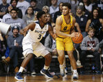 Marquette guard Markus Howard (0) looks to pass around Butler guard Kamar Baldwin (3) during the first half of an NCAA college basketball game in Indianapolis, Friday, Jan. 12, 2018. (AP Photo/AJ Mast)