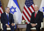 United States Vice President Mike Pence, right, talks to the media during a bilateral meeting with Israeli Prime Minister Benjamin Netanyahu, left, in Warsaw, Poland, Thursday, Feb. 14, 2019. The Polish capital is host for a two-day international conference on the Middle East, co-organized by Poland and the United States. (AP Photo/Michael Sohn)