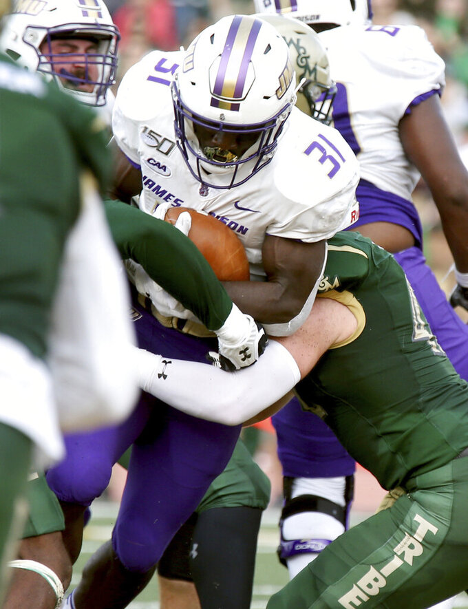 James Madison's Percy Agyei-Obese(31) pushes for a touchdown against William & Mary during the first half of of an NCAA college football game in Williamsburg, Va., on Saturday, Oct. 19, 2019.  (Daniel Sangjib Min/Richmond Times-Dispatch via AP)