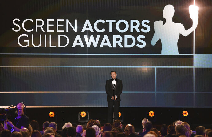 FILE - Leonardo DiCaprio presents the lifetime achievement award at the 26th annual Screen Actors Guild Awards in Los Angeles on  Jan. 19, 2020. The SAG Awards announced Wednesday, Jan. 13, 2021, that the 27th annual ceremony has been moved to April 4. The awards had been originally scheduled to air March 14, but shifted to a different date to avoid conflict with the Grammys. (AP Photo/Chris Pizzello, File)