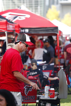 Fans tailgate ahead of an NFL football game, between the Atlanta Falcons and the Philadelphia Eagles, Sunday, Sept. 15, 2019, in Atlanta. (AP Photo/John Bazemore)