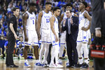 Duke coach Mike Krzyzewski talks with players during a timeout during the second half of the team's second-round game against Central Florida in the NCAA men's college basketball tournament Sunday, March 24, 2019, in Columbia, S.C. Duke won 77-76. (AP Photo/Sean Rayford)