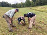 Volunteer trainer Bill Rose, left, watches veterans Katherine Kuzmick and Bjorn Bruckshaw work at an archaeological dig at the site of the Second Battle of Saratoga, Thursday, Sept. 9, 2021, in Stillwater, N.Y. Veterans with American Veterans Archaeological Recovery are searching for Revolutionary War artifacts at the Saratoga National Historical Park this month. (AP Photo/Michael Hill)