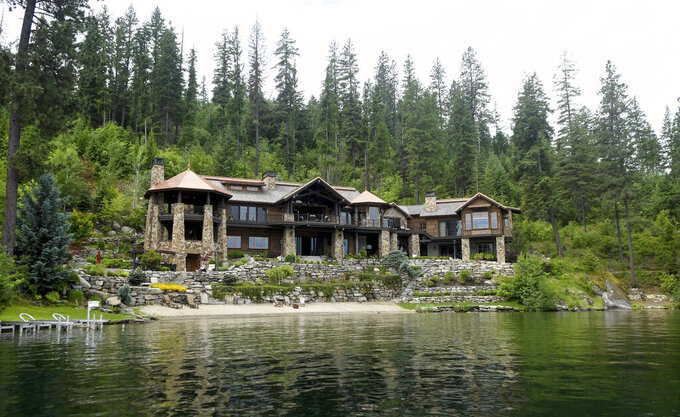 This $27 million lakefront mansion in Coeur d'Alene is photographed on Wednesday,  June 23, 2021. The Spokane real estate market is booming. Spokane County's median home price in May 2021 reached another all-time high at $375,000. That was 29.5% greater than the $289,900 median in May 2020, according to the Spokane Association of Realtors.  (Kathy Plonka/The Spokesman-Review via AP)